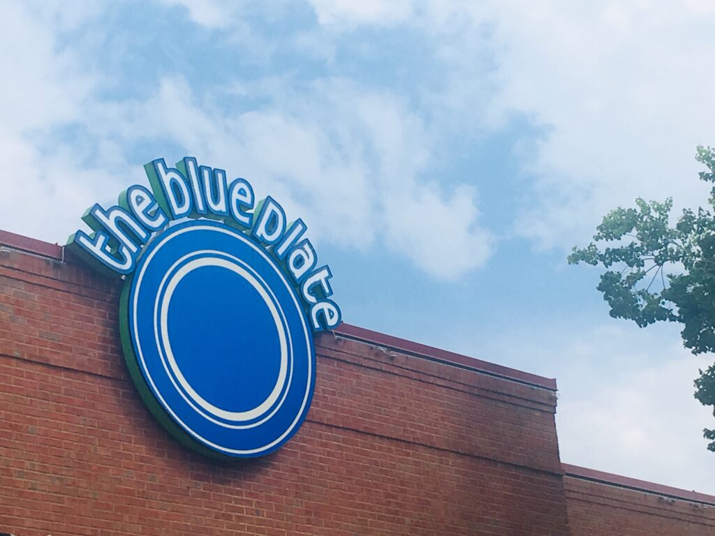 The Blue Plate signage on building